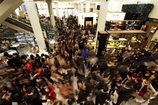People rush into a department store as it opens for Boxing Day sales in central London, Monday, Dec. 26, 2011. Despite disruptions caused by London&#39;s subway drivers striking over a pay dispute, large crowds of shoppers started flooding department stores in London as soon as doors opened early Monday. &#40;AP Photo&#47;Lefteris Pitarakis&#41; <span class=meta>(AP Photo&#47; Lefteris Pitarakis)</span>