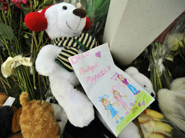 A hand-drawn card lays on top of a memorial area outside the home of Madonna Badger in Stamford, Conn., Tuesday, Dec. 27, 2011. A fire at the home on Christmas morning killed Badger&#39;s three daughters and parents. The Christmas Day fire was a tragic accident related to a fireplace in the home, not the result of foul play, Stamford Mayor Michael Pavia said Tuesday, Dec. 27, 2011. &#40;AP Photo&#47;Jessica Hill&#41; <span class=meta>(AP Photo&#47; Jessica Hill)</span>