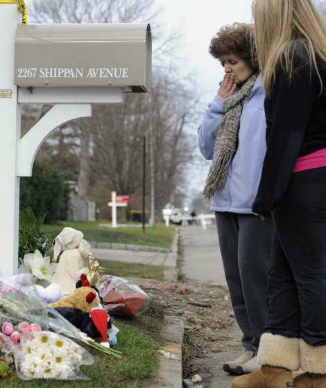 People pay their respects at a memorial area outside the home of Madonna Badger in Stamford, Conn., Tuesday, Dec. 27, 2011.  A fire at the home on Christmas morning killed Badger&#39;s three daughters and parents. The Christmas Day fire was a tragic accident related to a fireplace in the home, not the result of foul play, Stamford Mayor Michael Pavia said Tuesday, Dec. 27, 2011. &#40;AP Photo&#47;Jessica Hill&#41; <span class=meta>(AP Photo&#47; Jessica Hill)</span>