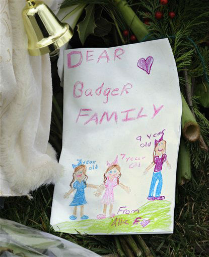 A hand-drawn card is placed in a memorial area outside the home of Madonna Badger in Stamford, Conn., Tuesday, Dec. 27, 2011. A fire at the home on Christmas morning killed Badger&#39;s three daughters and parents. The Christmas Day fire was a tragic accident related to a fireplace in the home, not the result of foul play, Stamford Mayor Michael Pavia said Tuesday, Dec. 27, 2011. &#40;AP Photo&#47;Jessica Hill&#41; <span class=meta>(AP Photo&#47; Jessica Hill)</span>