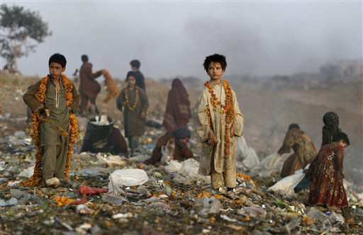 Afghan refugee children collect items of potential use from a pile of garbage on the outskirts of Islamabad, Pakistan Wednesday, Dec. 28, 2011. &#40;AP Photo&#47;Muhammed Muheisen&#41; <span class=meta>(AP Photo&#47; Muhammed Muheisen)</span>
