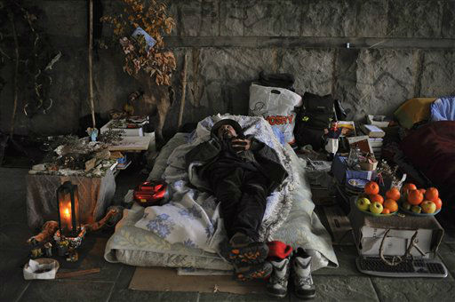 "<div class=""meta ""><span class=""caption-text "">Antxon, a Spanish unemployed homeless man, sleeps under a bridge in Pamplona northern Spain, Wednesday Dec. 28, 2011, while the Spanish Royal House has announced on its official website the  budget of Spanish King Juan Carlos and his family. This is the first time that the Spanish Royal House announces this. Spain suffers a strong economic crisis with more than five million unemployed. (AP Photo/Alvaro Barrientos) (AP Photo/ Alvaro Barrientos)</span></div>"
