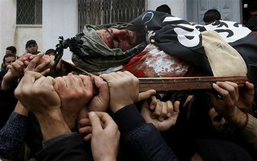 "<div class=""meta ""><span class=""caption-text "">Mourners carry the body of Palestinian militant Moumen Abu Daff during his funeral in Gaza City, Friday, Dec. 30, 2011. Moumen was killed and several other were wounded  in an Israeli air strike on the Gaza Strip Friday.(AP Photo/Hatem Moussa) (AP Photo/ Hatem Moussa)</span></div>"