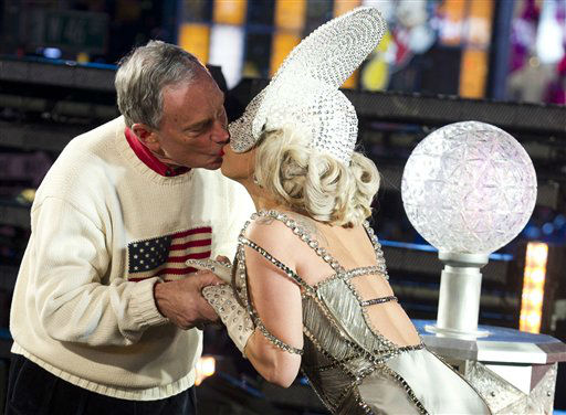 Lady Gaga and New York Mayor Michael Bloomberg, left, kiss during the 2012 New Year&#39;s Eve celebration, Saturday, Dec. 31, 2011, in New York. &#40;AP Photo&#47;Charles Sykes&#41; <span class=meta>(AP Photo&#47; Charles Sykes)</span>