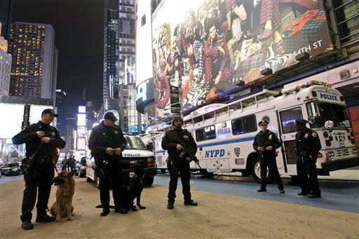 Heavily armed police officers stand guard during the New Year&#39;s Eve celebration in Times Square, Saturday, Dec. 31, 2011, in New York. &#40;AP Photo&#47;Mary Altaffer&#41; <span class=meta>(AP Photo&#47; Mary Altaffer)</span>