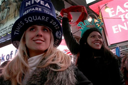 Michelle Ferreira, left, and Sayra Green take part in the New Year&#39;s Eve festivities in Times Square,Saturday Dec. 31, 2011, in New York. &#40;AP Photo&#47;Tina Fineberg&#41; <span class=meta>(AP Photo&#47; Tina Fineberg)</span>