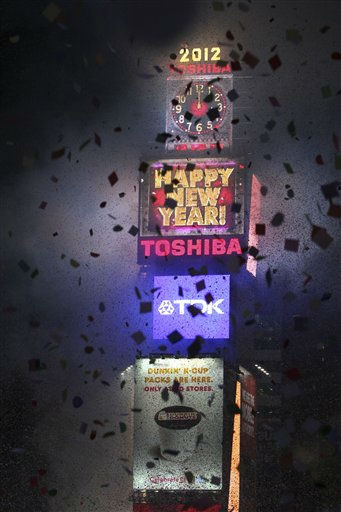 Confetti flies over Times Square as the clock strikes midnight during the New Year&#39;s Eve celebration as seen from the balcony of the Marriott Marquis hotel, Saturday, Dec. 31, 2011, in New York.   &#40;AP Photo&#47;Mary Altaffer&#41; <span class=meta>(AP Photo&#47; Mary Altaffer)</span>