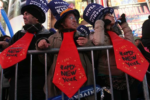 Wearing oversized festive ties, Carlos Garcia, left, his wife Maria Zamorano, center, and their daughter Paulina Garcia take part the New Year&#39;s Eve celebration in New York&#39;s Times Square Saturday Dec. 31, 2011.  The family is from Santiago, Chile. &#40;AP Photo&#47;Tina Fineberg&#41; <span class=meta>(AP Photo&#47; Tina Fineberg)</span>