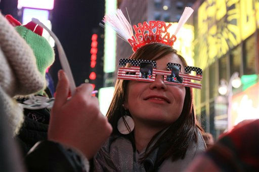 Wearing 2012 glasses and a Happy New Year headpiece, Bernadette Brandl smiles as she takes part in the New Year&#39;s Eve festivities in New York&#39;s Times Square Saturday Dec. 31, 2011. Brandl, who is originally from Austria, is currently living in Minnesota.  &#40;AP Photo&#47;Tina Fineberg&#41; <span class=meta>(AP Photo&#47; Tina Fineberg)</span>