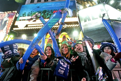 Samantha Rhodes, center, and Samantha Mitchell, of North Port, Fl., cheer during the New Year&#39;s Eve celebration in New York&#39;s Times Square, Saturday, Dec. 31, 2011  &#40;AP Photo&#47;Mary Altaffer&#41; <span class=meta>(AP Photo&#47; Mary Altaffer)</span>