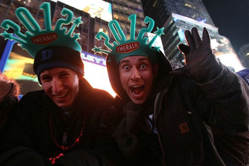 Austin Needham, left, and Justin Fulp, both from Winston-Salem, N.C., pose for a photograph as they take part in the New Year&#39;s Eve festivities in Times Square Saturday Dec. 31, 2011, in New York. Needham and Fulp said that they had been in Times Square since 6 o&#39;clock Friday evening.  &#40;AP Photo&#47;Tina Fineberg&#41; <span class=meta>(AP Photo&#47; Tina Fineberg)</span>