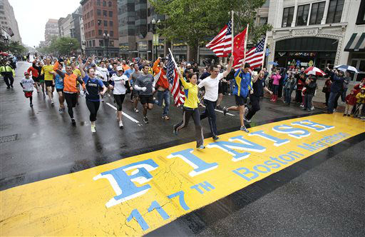 "<div class=""meta image-caption""><div class=""origin-logo origin-image ""><span></span></div><span class=""caption-text"">Runners who were unable to finish the Boston Marathon on April 15 because of the bombings cross the finish line on Boylston Street after the city allowed them to finish the last mile of the race in Boston, Saturday, May 25, 2013. (AP Photo/Winslow Townson) (AP Photo/ Winslow Townson)</span></div>"