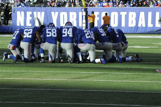 "<div class=""meta ""><span class=""caption-text "">New York Giants players gather during the first half of an NFL football game against the Philadelphia Eagles Sunday, Dec. 30, 2012 in East Rutherford, N.J. (AP Photo/Bill Kostroun) (AP Photo/ Bill Kostroun)</span></div>"