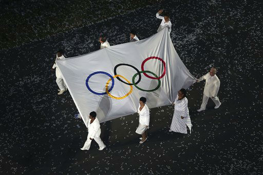 The Olympic flag is carried by Daniel Barenboim, Sally Becker, Shami Chakrabati CBE, Leymah Gbowee, Haile Gebrselassie, Doreen Lawrence OBE, Ban Ki-moon and Marina Silva during the Opening Ceremony of the 2012 Olympic Summer Games at the Olympic Stadium in London, Saturday, July 28, 2012. &#40;AP Photo&#47;Ezra Shaw, Pool&#41; <span class=meta>(AP Photo&#47; Ezra Shaw)</span>