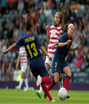 United States&#39; Alex Morgan, center, battles with Colombia&#39;s Yulieht Dominguez, left, and Natalia Gaitan, right, during the group G women&#39;s soccer match between the United States and Colombia at the London 2012 Summer Olympics, Saturday, July 28, 2012, at Hampden Park Stadium in Glasgow, Scotland. &#40;AP Photo&#47;Chris Clark&#41; <span class=meta>(AP Photo&#47; Chris Clark)</span>