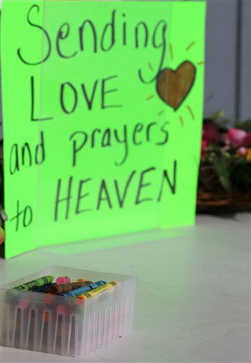 Crayons sit on a table outside of a barbershop a day after a gunman opened fire at Sandy Hook Elementary School, Saturday, Dec. 15, 2012, in the Sandy Hook village of Newtown, Conn. The massacre of 26 children and adults at Sandy Hook Elementary school elicited horror and soul-searching around the world even as it raised more basic questions about why the gunman, 20-year-old Adam Lanza, would have been driven to such a crime and how he chose his victims.  &#40;AP Photo&#47;Julio Cortez&#41; <span class=meta>(AP Photo&#47; Julio Cortez)</span>