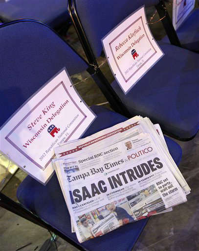 A newspaper headline is seen on the floor of the Republican National Convention in Tampa, Fla., on Sunday, Aug. 26, 2012, as weather forecasts continue to show Florida in the path of Tropical Storm Isaac. &#40;AP Photo&#47;Lynne Sladky&#41; <span class=meta>(AP Photo&#47; Lynne Sladky)</span>