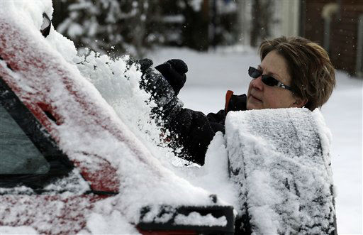 Kay Nelson scrapes ice and snow from her vehicle in Denver on Thursday, Feb. 21, 2013. A fast moving winter storm passed through Colorado Wednesday night and Thursday morning dropping as much as a foot of snow in areas of the state. &#40;AP Photo&#47;Ed Andrieski&#41; <span class=meta>(AP Photo&#47; Ed Andrieski)</span>