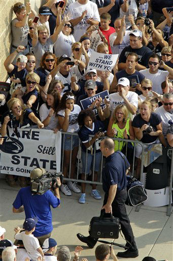 Penn State NCAA college football coach Bill O&#39;Brien, foreground, leads his team into Beaver Stadium for their season opener against Ohio in State College, Pa., Saturday, Sept. 1, 2012. &#40;AP Photo&#47;Gene J. Puskar&#41; <span class=meta>(AP Photo&#47; Gene J. Puskar)</span>