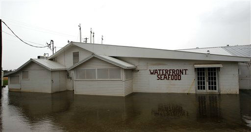 The Waterfront Seafood company is flooded as water covers Shell Belt Road in Bayou La Batre, Ala.  on Tuesday, Aug. 28, 2012.  The U.S. National Hurricane Center in Miami said Isaac became a Category 1 hurricane Tuesday with winds of 75 mph. It could get stronger by the time it&#39;s expected to reach the swampy coast of southeast Louisiana. &#40;AP Photo&#47;Butch Dill&#41; <span class=meta>(AP Photo&#47; Butch Dill)</span>