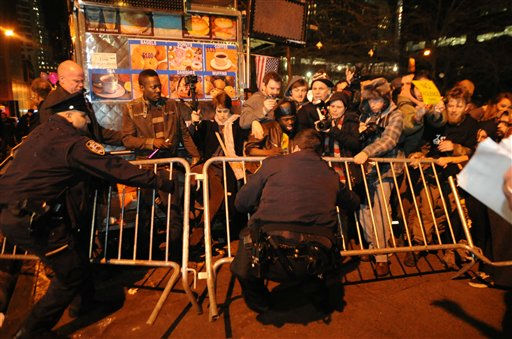 Occupy Wall Street protesters and New York Police clash over poice barricades at Zuccotti Park Saturday Dec. 31, 2011 in New York.  The demonstraters returned to the Park Saturday after being evicted by police in November.  &#40;AP Photo&#47;Stephanie Keith&#41; <span class=meta>(AP Photo&#47; Stephanie Keith)</span>