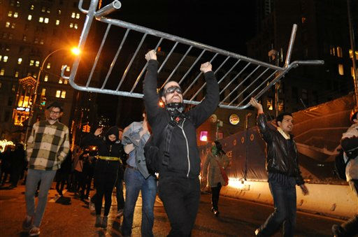 Occupy Wall Street protesters carry a barricade they removed from Zuccotti Park in New York Saturday Dec. 31, 2011. The protesters took police barricades, piled them up and celebrated on top of them. &#40;AP Photo&#47;Sstephanie Keith&#41; <span class=meta>(AP Photo&#47; Stephanie Keith)</span>