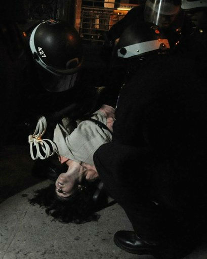 Police arrest a protester in New York Saturday Dec, 31, 2011 as the Occupy Wall Street protesters marched in lower Manhattan.   The protesters went to Zuccotti Park then marched through parts of lower Manhattan.  &#40;AP Photo&#47;Stephanie Keith&#41; <span class=meta>(AP Photo&#47; Stephanie Keith)</span>