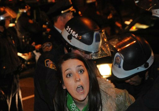 An Occupy Wall Street protester is arrested by police Sunday Jan. 1, 2012 in New York. Protesters clashed with police as they marched through lower Manhattan.  &#40;AP Photo&#47;Stephanie Keith&#41; <span class=meta>(AP Photo&#47; Stephanie Keith)</span>