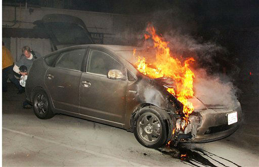 "<div class=""meta ""><span class=""caption-text "">A car owner tries to retrieve possessions from his vehicle as it burns due to arson early Monday, Jan. 2, 2012, in a parking lot in Los Angeles. Eleven more suspected arson fires broke out early Monday in Los Angeles.  A person of interest was taken into custody for questioning in connection with the dozens of suspicious car fires that have hit the city since last week. (AP Photo/Mike Meadows) (AP Photo/ MIKE MEADOWS)</span></div>"
