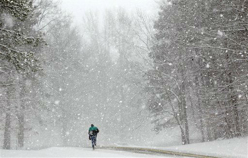 "<div class=""meta ""><span class=""caption-text "">A lone walker braves falling snow at the Cleveland Metroparks South Chagrin Reservation in Bentleyville, Ohio as high winds and heavy snow was expected to fall throughout northeast Ohio much of the day on Monday, Jan. 2, 2012.  (AP Photo/Amy Sancetta) (AP Photo/ Amy Sancetta)</span></div>"
