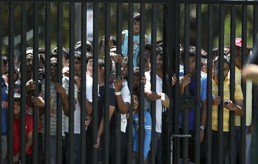 "<div class=""meta image-caption""><div class=""origin-logo origin-image ""><span></span></div><span class=""caption-text"">India cricket fans crowd at a gate to get a glimpse of their team during a training in Sydney, Australia, Monday, Jan. 2, 2012. Australia will play India in the second test on Tuesday. (AP Photo/Rob Griffith) (AP Photo/ Rob Griffith)</span></div>"