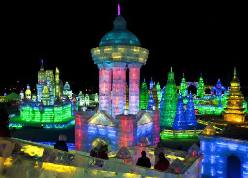 Visitors view buildings made from blocks of ice for the Harbin International Ice and Snow Festival in Harbin in northeastern China&#39;s Heilongjiang province, on Wednesday, Jan. 4, 2012. The festival is scheduled to officially open on Thursday night, Jan. 5.  &#40;AP Photo&#47;Andy Wong&#41; <span class=meta>(AP Photo&#47; Andy Wong)</span>
