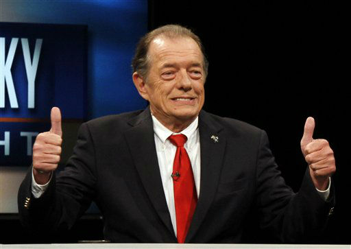 In this Sept. 26, 2011 photo, Independent Kentucky gubernatorial candidate Gatewood Galbraith gives thumbs up before a debate at Kentucky Educational Television in Lexington, Ky.. Galbraith died in his home in Lexington on Jan. 4, 2012.   The running mate of Lexington attorney Gatewood Galbraith says the perennial candidate for office has died. Dea Riley, who ran for lieutenant governor in November on the Galbraith ticket, confirmed his death Wednesday, Jan. 4, 2012.   Riley said Galbraith died Tuesday.   The 64-year-old Galbraith, whose one-liners even on serious issues often drew chuckles from audiences, told an Associated Press reporter in September that he would die smiling. &#40;AP Photo&#47; James Crisp&#41; <span class=meta>(AP Photo&#47; James Crisp)</span>