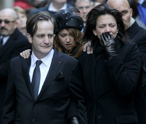 Matthew Badger, left, and Madonna Badger, the parents of three children that were killed in a fire, react as their caskets are carried into a church during the funeral in New York, Thursday, Jan. 5, 2012. Hundreds of people streamed into a historic church in the heart of Manhattan on Thursday for the funeral of three young girls who died along with their grandparents during a Christmas morning fire in Stamford, Conn.  &#40;AP Photo&#47;Seth Wenig&#41; <span class=meta>(AP Photo&#47; Seth Wenig)</span>