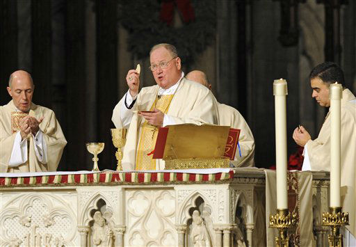 "<div class=""meta ""><span class=""caption-text "">New York Archbishop Timothy Dolan celebrates mass at Saint Patrick's Cathedral, Friday, Jan 6, 2012, in New York. Cardinal Designate Dolan is one of 22 prelates who will be elevated to cardinal in the Roman Catholic Church in a formal ceremony on Feb. 18.  Pope Benedict XVI made the announcement in Rome on Friday. (AP Photo/ Louis Lanzano) (AP Photo/ Louis Lanzano)</span></div>"