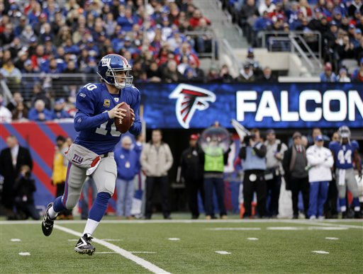 New York Giants quarterback Eli Manning scrambles to pass during the first half of an NFL wild card playoff football game against the Atlanta Falcons Sunday, Jan. 8, 2012, in East Rutherford, N.J. &#40;AP Photo&#47;Matt Slocum&#41; <span class=meta>(AP Photo&#47; Matt Slocum)</span>