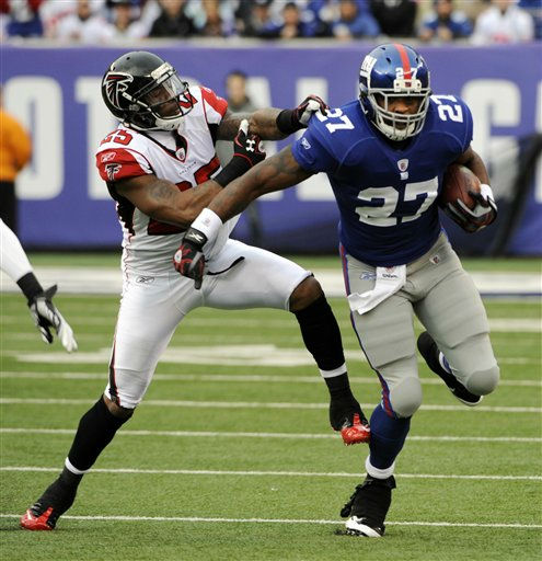 Atlanta Falcons strong safety William Moore &#40;25&#41; tries to stop New York Giants running back Brandon Jacobs &#40;27&#41; during the first half of an NFL wild card playoff football game Sunday, Jan. 8, 2012, in East Rutherford, N.J. &#40;AP Photo&#47;Bill Kostroun&#41; <span class=meta>(AP Photo&#47; Bill Kostroun)</span>