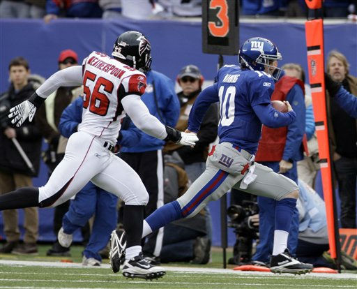 New York Giants quarterback Eli Manning &#40;10&#41; is chased by Atlanta Falcons outside linebacker Sean Weatherspoon &#40;56&#41; during the first half of an NFL wild card playoff football game Sunday, Jan. 8, 2012, in East Rutherford, N.J. &#40;AP Photo&#47;Peter Morgan&#41; <span class=meta>(AP Photo&#47; Peter Morgan)</span>