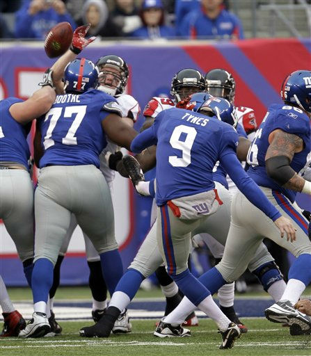 New York Giants kicker Lawrence Tynes &#40;9&#41; kicks a 22-yard field goal against the Atlanta Falcons during the second half of an NFL wild card playoff football game Sunday, Jan. 8, 2012, in East Rutherford, N.J. &#40;AP Photo&#47;Julio Cortez&#41; <span class=meta>(AP Photo&#47; Julio Cortez)</span>
