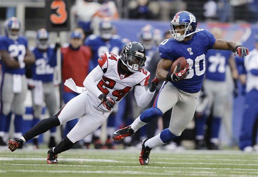 New York Giants wide receiver Victor Cruz &#40;80&#41; evades a tackle by Atlanta Falcons cornerback Dominique Franks &#40;24&#41; during the second half of an NFL wild card playoff football game Sunday, Jan. 8, 2012, in East Rutherford, N.J. &#40;AP Photo&#47;Matt Slocum&#41; <span class=meta>(AP Photo&#47; Matt Slocum)</span>