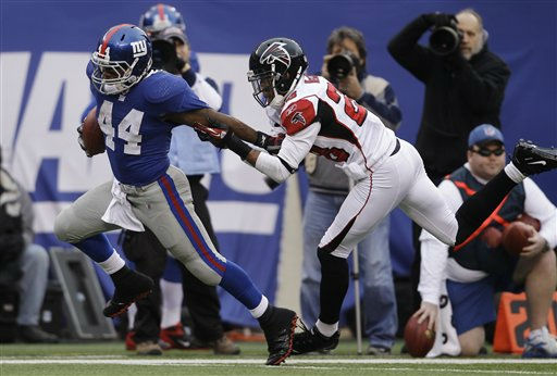 Atlanta Falcons free safety Thomas DeCoud &#40;28&#41; tries to stop New York Giants running back Ahmad Bradshaw on a 30-yard run during the second half of an NFL wild card playoff football game Sunday, Jan. 8, 2012, in East Rutherford, N.J. &#40;AP Photo&#47;Matt Slocum&#41; <span class=meta>(AP Photo&#47; Matt Slocum)</span>