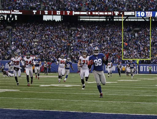 New York Giants wide receiver Hakeem Nicks runs into the end zone to score on a 72-yard touchdown pass against the Atlanta Falcons during the second half of an NFL wild card playoff football game Sunday, Jan. 8, 2012, in East Rutherford, N.J. &#40;AP Photo&#47;Matt Slocum&#41; <span class=meta>(AP Photo&#47; Matt Slocum)</span>