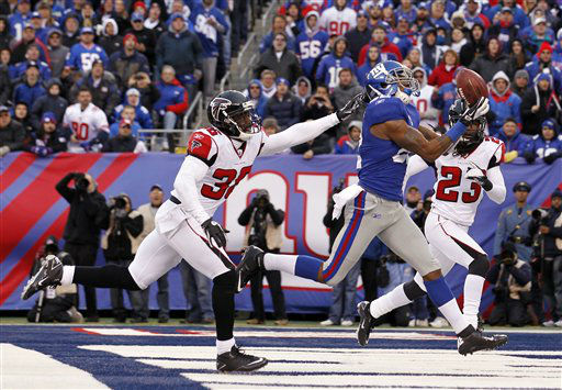 New York Giants wide receiver Mario Manningham &#40;82&#41; pulls in a 27-yard touchdown pass against Atlanta Falcons strong safety James Sanders &#40;36&#41; and Dunta Robinson during the second half of an NFL wild card playoff football game Sunday, Jan. 8, 2012, in East Rutherford, N.J. &#40;AP Photo&#47;Julio Cortez&#41; <span class=meta>(AP Photo&#47; Julio Cortez)</span>