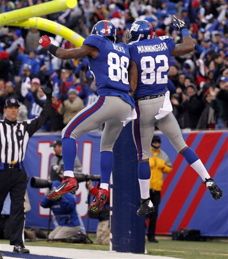 New York Giants wide receiver Mario Manningham &#40;82&#41; celebrates his 27-yard touchdown pass against Atlanta Falcons with teammate Hakeem Nicks during the second half of an NFL wild card playoff football game Sunday, Jan. 8, 2012, in East Rutherford, N.J. &#40;AP Photo&#47;Julio Cortez&#41; <span class=meta>(AP Photo&#47; Julio Cortez)</span>