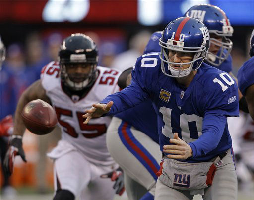 New York Giants quarterback Eli Manning &#40;10&#41; pitches out the ball during the second half of an NFL wild card playoff football game Sunday, Jan. 8, 2012, in East Rutherford, N.J. Left is Atlanta Falcons defensive end John Abraham &#40;55&#41;. &#40;AP Photo&#47;Matt Slocum&#41; <span class=meta>(AP Photo&#47; Matt Slocum)</span>