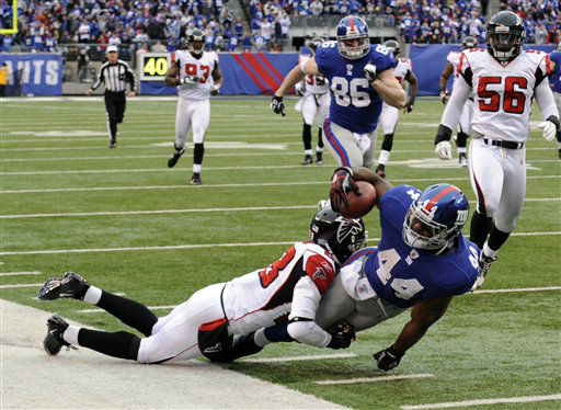 New York Giants running back Ahmad Bradshaw &#40;44&#41; is brought down by Atlanta Falcons free safety Thomas DeCoud &#40;28&#41; after a 30-yard run during the second half of an NFL wild card playoff football game Sunday, Jan. 8, 2012, in East Rutherford, N.J. &#40;AP Photo&#47;Bill Kostroun&#41; <span class=meta>(AP Photo&#47; Bill Kostroun)</span>