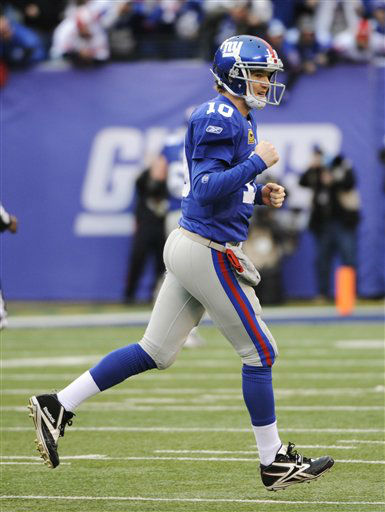 New York Giants quarterback Eli Manning celebrates after his 27-yard touchdown pass to  Mario Manningham against the Atlanta Falcons during the second half of an NFL wild card playoff football game Sunday, Jan. 8, 2012, in East Rutherford, N.J. &#40;AP Photo&#47;Bill Kostroun&#41; <span class=meta>(AP Photo&#47; Bill Kostroun)</span>