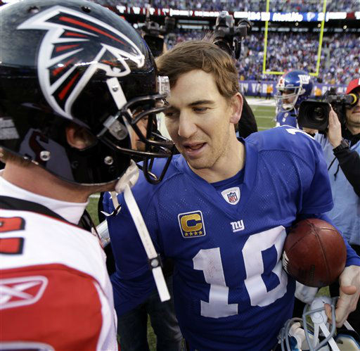 New York Giants quarterback Eli Manning &#40;10&#41; chats with Atlanta Falcons quarterback Matt Ryan after their NFL wild card playoff football game Sunday, Jan. 8, 2012, in East Rutherford, N.J. The Giants defeated the Falcons 24-2. &#40;AP Photo&#47;Julio Cortez&#41; <span class=meta>(AP Photo&#47; Julio Cortez)</span>