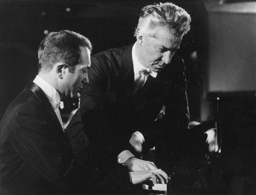 FILE This is a 1976 file photo of pianist Alexis Weissenberg. left, and  Austrian conductor Herbert von Karajan , as they go over a part at the grand piano in West Berlin.  Bulgarian-born pianist Alexis Weissenberg, whose love of music from the age of 3 saved him and his mother in a concentration camp and carried him to the heights of 20th century performances with Herbert von Karajan and Leonard Bernstein, has died. He was 82. Bulgaria&#39;s Ministry of Culture confirmed Monday Jan. 9, 2012 the death of Weissenberg, who was born in the capital Sofia but spent most of his life abroad and became a French citizen. &#40;AP Photo, File&#41; <span class=meta>(AP Photo&#47; GH JF**LON**)</span>