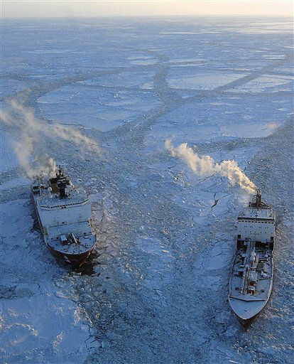 In this photo provided by the US Coast Guard, the cutter Healy, left, breaks ice around the Russian tanker Renda in the Bering Sea Tuesday, Jan. 10, 2012, 97 miles south of Nome, Alaska. The two vessels departed Dutch Harbor for Nome on Jan. 3, 2012, to deliver more than 1.3 million gallons of petroleum products. &#40;AP Photo&#47;U.S. Coast Guard&#47;Petty Officer 1st Class Sara Francis&#41; <span class=meta>(AP Photo&#47; Sara Francis)</span>
